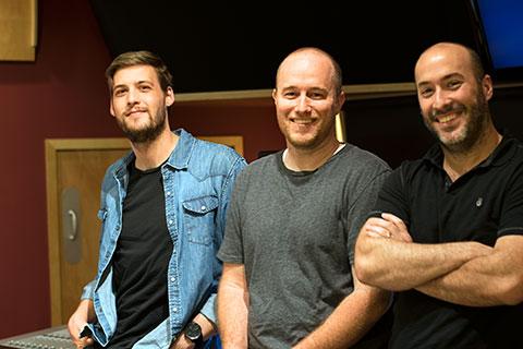 Assistant Christian Wenger, Composer Christian Davis, and DK